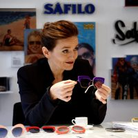 Italian eyewear group Safilo CEO Luisa Delgado holds a pair of sunglasses during Reuters interview in a showroom in Milan