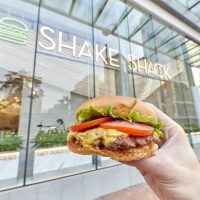 "Shake Shack is set to open its second store in Hong Kong on 21 November. Located at Pacific Place, the new branch will give out 200 Shake Shack tote bags on a first-come-first-serve basis. In addition to the Shack classics and the Hong Kong exclusive milk tea shake, the new store will introduce a selection of local menu items, including a new series of ""concrete"" (custard desserts) – matcha golden bell, open sesame and queensway crunch. Shake Shack will launch three holiday shakes – Christmas cookie, chocolate peppermint, and Hazelnut – to celebrate the festive season. All of which are topped with whipped cream and decorated with colourful sprinkles. The holiday shakes will be available for a limited time at both Pacific Place and ifc mall. Echoing with Shake Shack's mission to Stand For Something Good®, the Pacific Place store will donate 5% of sales from its matcha golden bell concrete to the i-dArt programme of Tung Wah Group of Hospitals, a non-profit organisation that promotes social inclusion by encouraging people with differing abilities to participate in art. Shake Shack is ramping up its effort on global expansion. In a statement, Randy Garutti, CEO of Shake Shack, said the company entered into licensing agreements to open more than 50 stores in the Philippines, Mexico and Singapore over the next decade. The company expects to open its first stores in Singapore and Mexico in 2019."